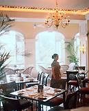CHINA, Macau, Asia, Grand Lapa Hotel, waitress standing in Bella Vista Cafe