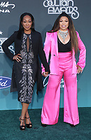 17 November 2019 - Las Vegas, NV - Tichina Arnold, Tisha Campbell. 2019 Soul Train Awards Red Carpet Arrivals at Orleans Arena. Photo Credit: MJT/AdMedia