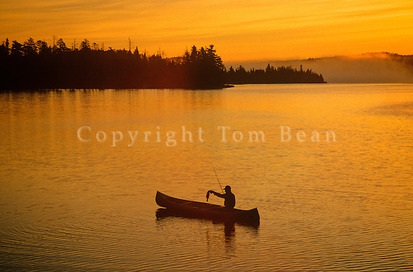 Fishing at sunrise, Boundary Waters Canoe Area lake, border of Minnesota and Ontario, Canada, USA, AGPix_0313.