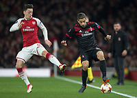 Ricardo Rodríguez of AC Milan and Mesut Ozil of Arsenal in action during the UEFA Europa League round of 16 2nd leg match between Arsenal and AC Milan at the Emirates Stadium, London, England on 15 March 2018. Photo by Vince  Mignott / PRiME Media Images.