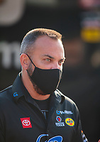 Jul 19, 2020; Clermont, Indiana, USA; NHRA top fuel driver Tony Schumacher wears a face mask during the Summernationals at Lucas Oil Raceway. Mandatory Credit: Mark J. Rebilas-USA TODAY Sports