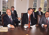 In this file photo dated January 24, 1989, the Speaker of the United States House of Representatives Jim Wright (Democrat of Texas), left, Shares some laughs as he presents U.S. President George H.W. Bush, center, a bottle of hot sauce during a meeting of Congressional Leaders at the White House in Washington, D.C.  U.S. Senate Majority Leader George Mitchell (Democrat of Maine) looks on from right.  Wright passed away at age 92 on May 6, 2015.<br /> Credit: Ron Sachs / CNP