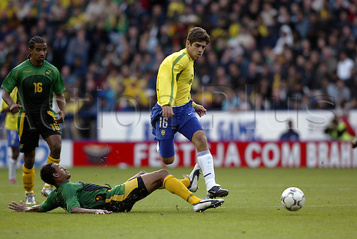 October 12, 2003: Brazilian player JUNINHO PERNAMBUCANO skips past a challenge from Tyrone Marshall during their friendly match against Jamaica, Jamaica 0 v BRAZIL 1, International Friendly, Walkers Stadium, Leicester Photo: Neil Tingle/action plus...031012 Soccer Football
