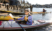 Lorna Johnston of Kirkland, left, prepares to launch as Washington Water Trails Association outreach director Sarah Krueger puts on her spray skirt at a public access point on Salmon Bay in Seattle Saturday Dec. 8, 2007.