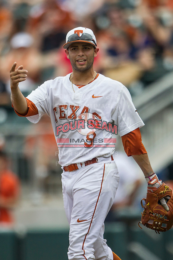 Texas Longhorns shortstop CJ Hinojosa #9 during the NCAA baseball game against the Oklahoma State Cowboys on April 26, 2014 at UFCU Disch–Falk Field in Austin, Texas. The Cowboys defeated the Longhorns 2-1. (Andrew Woolley/Four Seam Images)