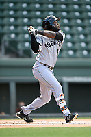 Left fielder Jean Angomas (6) of the Augusta GreenJackets bats in a game against the Greenville Drive on Wednesday, April 25, 2018, at Fluor Field at the West End in Greenville, South Carolina. Augusta won, 9-2. (Tom Priddy/Four Seam Images)