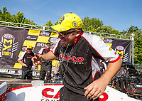 Jun 11, 2017; Englishtown , NJ, USA; Crew member for NHRA top fuel driver Steve Torrence is doused with a cooler of ice water as he celebrates after winning the Summernationals at Old Bridge Township Raceway Park. Mandatory Credit: Mark J. Rebilas-USA TODAY Sports