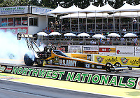 Aug. 3, 2014; Kent, WA, USA; NHRA top fuel dragster driver Tony Schumacher during the Northwest Nationals at Pacific Raceways. Mandatory Credit: Mark J. Rebilas-