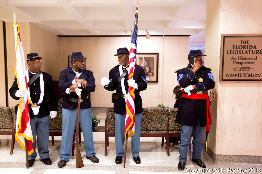 TALLAHASSEE, FLA. 3/5/13-OPENING030513CH-Members of the U.S. Colored Troops 2nd Infantry reenactment group wait to carry the colors into the House Chamber before the opening day of the 2013 legislative session Tuesday at the Capitol in Tallahassee, Fla. The group, made up of retired military, pays tribute to the freed slaves who served in the Union Army and fought at the 1865 Battle of Natural Bridge south of Tallahassee..COLIN HACKLEY PHOTO