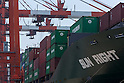 Tokyo, Japan - Piles of containers are shown on a ship docked in cargo area at a port in Tokyo, May 22, 2013. Japan posts a record-high of 879.9 billion yen ($8.6 billion USD) trade deficit for April as the weaker yen caused the increase the costs of imports.