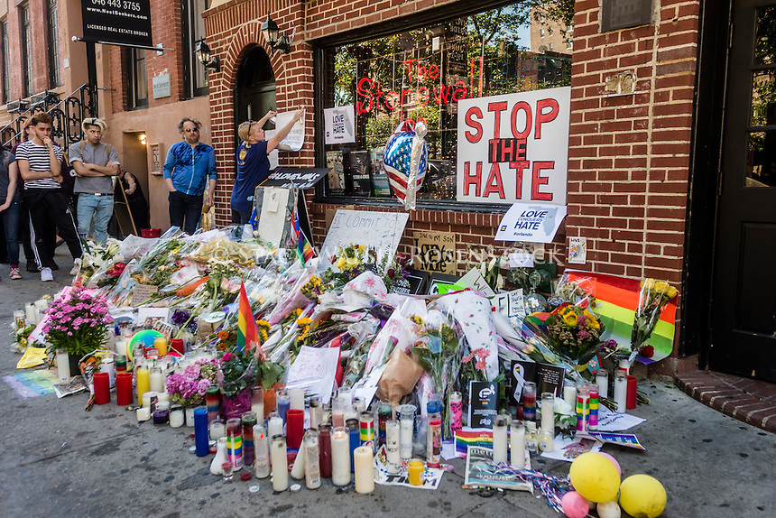 New York, USA 14 June 2016 - Three days after a mass shooting that left at 49 people dead and 50 others wounded at Pulse, a gay nightclub in Orlando, Florida, a silent vigil continues at the Stonewall Inn,  Christopher Street, Stonewall Place. <br />  &copy;Stacy Walsh Rosenstock