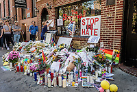New York, USA 14 June 2016 - Three days after a mass shooting that left at 49 people dead and 50 others wounded at Pulse, a gay nightclub in Orlando, Florida, a silent vigil continues at the Stonewall Inn,  Christopher Street, Stonewall Place. <br />