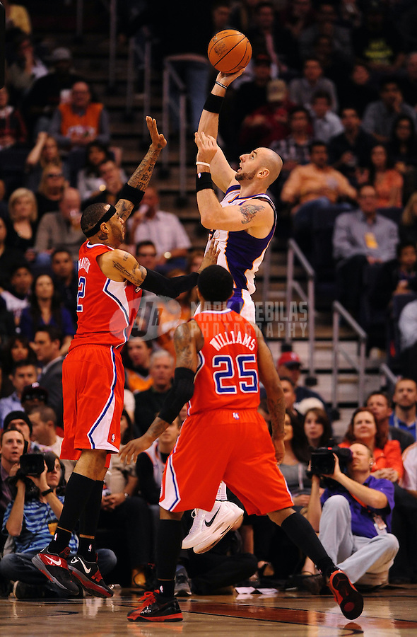 Mar. 2, 2012; Phoenix, AZ, USA; Phoenix Suns center Marcin Gortat takes a shot under pressure from Los Angeles Clippers forward Kenyon Martin at the US Airways Center. The Suns defeated the Clippers 81-78. Mandatory Credit: Mark J. Rebilas-USA TODAY Sports