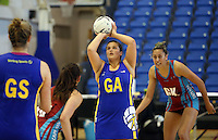 29.09.2014 Dunedin's Olivia Bates in action during the Dunedin v Kapi Mana match duing the Lion Foundation Netball Champs at the Trusts Stadium in Auckland. Mandatory Photo Credit ©Michael Bradley.
