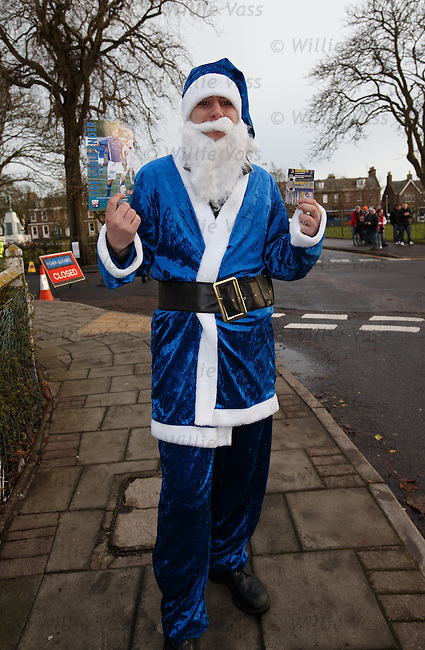 Rangers fan in full blue Santa kit on the way to the match