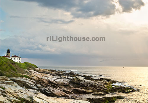 Waves shimmer in the sunlight as they break by the Beavertail Light.