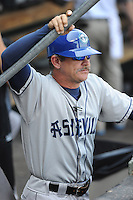 Manager Joe Mikulik (20) of the Asheville Tourists prior to a game against the Greenville Drive on Sunday, August 26, 2012, at Fluor Field at the West End in Greenville, South Carolina. (Tom Priddy/Four Seam Images)