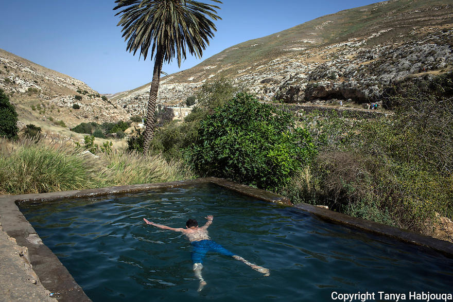 West Bank: A Palestinian youth from Hebron enjoys a swim in Ein Farha, considered to be one of the most beautiful nature spots in the entire West Bank. It, like many other nature reserves and heritage sites in the West Bank, is managed by the Israeli Nature and Parks Authority. 2013