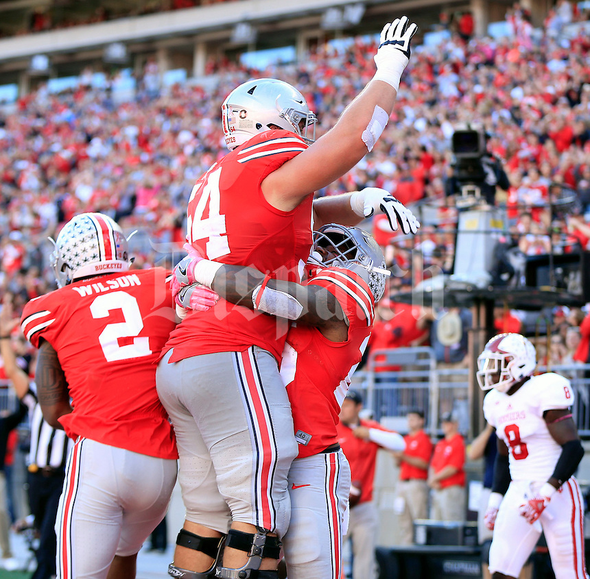 Ohio State Buckeyes running back Mike Weber (25) celebrates his touchdown run by hosting up Ohio State Buckeyes offensive lineman Billy Price (54) during the 1st half of their game in Ohio Stadium in Columbus, Ohio on October 8, 2016.  (Kyle Robertson/ The Columbus Dispatch)