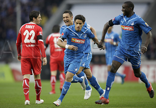Hoffenheims Sejad Salihovic (2L-R), scorer Carlos Eduardo and Demba Ba celebrate the 0-1 lead goal next to a dejected looking Fabrice Ehret of Cologne (L) during the German Bundesliga soccer match FC Cologne vs 1899 Hoffenheim at RheinEnergieStadium in Cologne, Germany, 21 November 2009. Photo: ROLF VENNENBERND/Actionplus UK Editorial Only