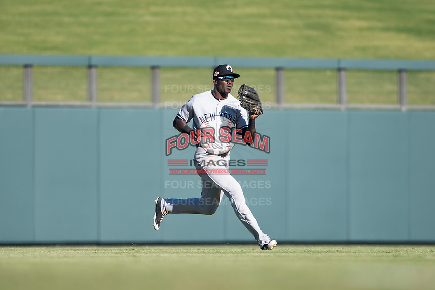 Glendale Desert Dogs left fielder Estevan Florial (13), of the New York Yankees organization, catches a fly ball during an Arizona Fall League game against the Salt River Rafters at Salt River Fields at Talking Stick on October 31, 2018 in Scottsdale, Arizona. Glendale defeated Salt River 12-6 in extra innings. (Zachary Lucy/Four Seam Images)