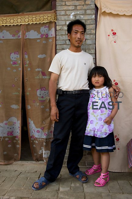 Farmer Su Yanlong and his daughter received a microfinance loan, near Yongji, Shanxi province, China, on June 12, 2010. Photo by Lucas Schifres/Pictobank
