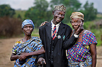 A local chief stands with his two wives who both underwent successful cataract operations carried out by ophthalmologist Dr Richard Hardi in the remote village of Pania. <br /> <br />  From his base in Mbuji Mayi Hungarian Ophthalmologist Friar Richard Hardi and his team travelled deep into the Congolese rainforest, by 4x4 and canoe, to treat people in isolated communities most of whom have never seen an Ophthalmologist. At a small village called Pania they established a temporary field hospital and over the next three days made hundreds of consultations. Although both conditions are preventable, many of the patients they saw had Glaucoma or River Blindness (onchocerciasis) that had permanently damaged their eyesight. However, patients with cataracts, a clouding of the eye's lens, who were suitable for treatment were booked for an operation. For two days the team carried out the ten minute procedure on one patient after another. The surgery involves making a 2.2mm incision into the remove the damaged lens that is then replaced by an artificial one. Doctor Hardi is one of the few people willing to make such a journey but is inspired to do so by his faith and, as he says: 'Here I feel that I can really make a difference in people's lives'. /Felix Features