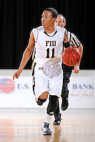 12 January 2012:  FIU guard Phil Taylor (11) handles the ball in the second half as the Middle Tennessee State University Blue Raiders defeated the FIU Golden Panthers, 70-59, at the U.S. Century Bank Arena in Miami, Florida.