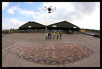 BNPS.co.uk (01202 558833)<br /> Pic: KitFanner/OnLocationEvents/BNPS<br /> <br /> *Please use full byline*<br /> <br /> Co-ordinating the shoot for the massive rug, with the drone above.<br /> <br /> We're gonna need a bigger house!<br /> <br /> Prospective buyers of this rare rug will need both deep pockets and a massive house - because it measures 40ft long and comes with a whopping &pound;20,000 price tag.<br /> <br /> The giant Persian rug, dating back to the late 19th century when it was hand-knotted in India, was recently removed from a Victorian mansion near Salisbury, Wilts.<br /> <br /> At 660sq ft it is so big that staff at Netherhampton Salerooms had to use a drone to photograph it.