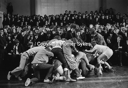 Westminster School annual Shrove Tuesday Pancake Grease Greaze Westminster, London, England 1976. Boys scramble for a piece of the pancake.