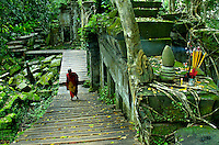 A buddhist Monk at the BENG MEALEA TEMPLE during the Monsoon season