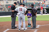 Kannapolis Intimidators guest manager Betty Altschuler delivers the line-up card to home plate umpire Mark Bass as Hickory Crawdads manager Spike Owen (11), Kannapolis Intimidators manager Justin Jirschele (9) and umpire  Darrell Roberts look on at Kannapolis Intimidators Stadium on April 22, 2017 in Kannapolis, North Carolina.  The Intimidators defeated the Crawdads 10-9 in 12 innings.  (Brian Westerholt/Four Seam Images)