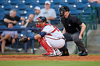 Mississippi Braves catcher Alex Jackson (25) in front of home plate umpire Matt Winter during a game against the Mobile BayBears on May 7, 2018 at Trustmark park in Pearl, Mississippi.  Mobile defeated Mississippi 5-0.  (Mike Janes/Four Seam Images)