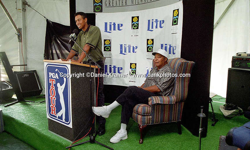 Tiger Woods, and his father, Earl,  at his press conference at his first professional golf tournament at the Greater Milwaukee Open in Milwaukee, Wisconsin.