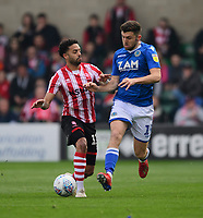 Lincoln City's Bruno Andrade vies for possession with Macclesfield Town's James Pearson<br /> <br /> Photographer Chris Vaughan/CameraSport<br /> <br /> The EFL Sky Bet League Two - Lincoln City v Macclesfield Town - Saturday 30th March 2019 - Sincil Bank - Lincoln<br /> <br /> World Copyright © 2019 CameraSport. All rights reserved. 43 Linden Ave. Countesthorpe. Leicester. England. LE8 5PG - Tel: +44 (0) 116 277 4147 - admin@camerasport.com - www.camerasport.com