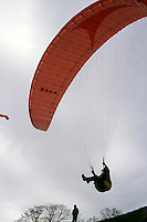 AIR SPORTS<br /> Paraglider Taking Off<br /> A foot launched, aerofoil canopy made of Dacron, designed to be flown and landed with no other energy requirements than wind gravity and pilot's muscle power. Newton's Second Law.