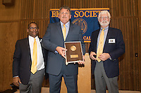 OAKLAND, CA - November 4, 2016: 2016  (Left to right) Cal Athletic Director Mike Williams, inductee Jack Clark, and Big C Society President Kent Brewer at the Big C Society 31st Annual Hall of Fame Banquet at the Greek Orthodox Cathedral.