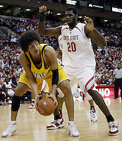 2 December 2006: Ohio State's Greg Oden, right, defends against Valparaiso's Urule Igbavboa at Value City Arena in Columbus, Ohio. Oden was the nation's top high school player for the past two years and made his college debut tonight after sitting out with a wrist injury.<br />