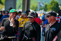 Jun 17, 2018; Bristol, TN, USA; NHRA top fuel driver Clay Millican (left) talks with Steve Torrence (center) and Pat Dakin during the Thunder Valley Nationals at Bristol Dragway. Mandatory Credit: Mark J. Rebilas-USA TODAY Sports