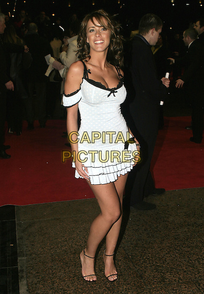 NICOLA T.Hitch Uk Premiere,.Odeon Cinema Leicester Square,.London, February 22nd 2005..full length wheels and dollbay dress blue black bows nichola.Ref: AH.www.capitalpictures.com.sales@capitalpictures.com.©Capital Pictures.