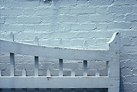 White wooden fence against white brick wall<br />