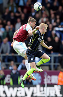 Burnley's Johann Gudmundsson vies for possession with Manchester City's Oleksandr Zinchenko<br /> <br /> Photographer Rich Linley/CameraSport<br /> <br /> The Premier League - Burnley v Manchester City - Sunday 28th April 2019 - Turf Moor - Burnley<br /> <br /> World Copyright © 2019 CameraSport. All rights reserved. 43 Linden Ave. Countesthorpe. Leicester. England. LE8 5PG - Tel: +44 (0) 116 277 4147 - admin@camerasport.com - www.camerasport.com