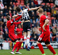 Grimsby Town's Calum Dyson and Leyton Orient's Nicky Hunt tussle during the Sky Bet League 2 match between Leyton Orient and Grimsby Town at the Matchroom Stadium, London, England on 11 March 2017. Photo by Carlton Myrie / PRiME Media Images.