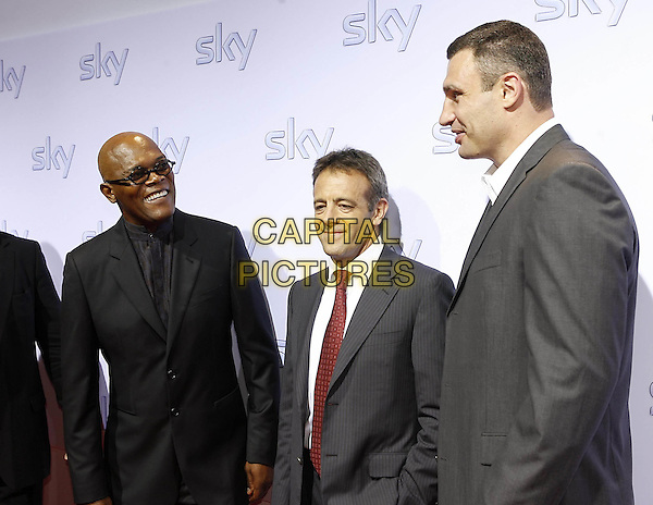 SAMUEL L. JACKSON, MARK WILLIAMS (CEO of Sky) & VITALI KLITSCHKO.Sky pay TV launch party, Schrannenhalle, Munich, Germany..July 3rd, 2009.half length black grey gray suit jacket glasses profile red tie .CAP/PPG/TF.©T. Furthmayr/People Picture/Capital Pictures