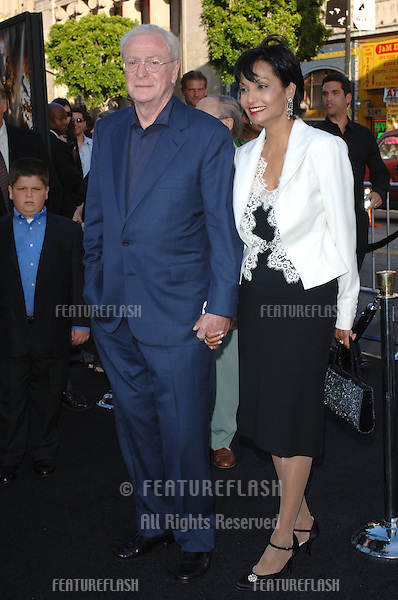 Actor MICHAEL CAINE & wife SHAKIRA at the Los Angeles premiere of his new movie Batman Begins..June 6, 2005 Los Angeles, CA..© 2005 Paul Smith / Featureflash