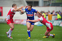Wakefield Trinity wildcats' Lee Smith is tackled by Hull Kingston Rovers' Michael Dobson, left, and Hull Kingston Rovers' Liam Salter <br /> <br />  (Photo by Chris Vaughan/CameraSport) <br /> <br /> Rugby League - Stobart Super League - Hull Kingston Rovers v Wakefield Wildcats - Sunday 19th May 2013 - MS3 Craven Park - Hull<br /> <br /> © CameraSport - 43 Linden Ave. Countesthorpe. Leicester. England. LE8 5PG - Tel: +44 (0) 116 277 4147 - admin@camerasport.com - www.camerasport.com