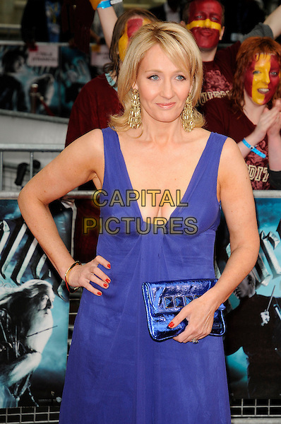 "JK ROWLING aka Joanne ""Jo"" Murray.Arriving at the World Premiere of ""Harry Potter and the Half-Blood Prince"" at the Odeon cinema, Leicester Square, London, England, UK, July 7th 2009..Half Blood  length blue long maxi dress clutch bag cleavage hand on hip earrings gold bracelet red nails .CAP/CAN.©Can Nguyen/Capital Pictures"