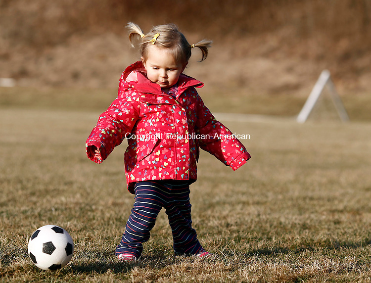 Middlebury, CT- 17 January 2014-011714CM03-  Charlotte Davis, 21 months, of Lexington, MA kicks the soccer ball at Meadowview Park in Middlebury on Friday.  Charlotte was with her brother Nate, 4, and mom Jamie visiting their grandfather Jim Levine, of Middlebury and were enjoying the milder weather by kicking around the soccer ball.    Christopher Massa Republican-American