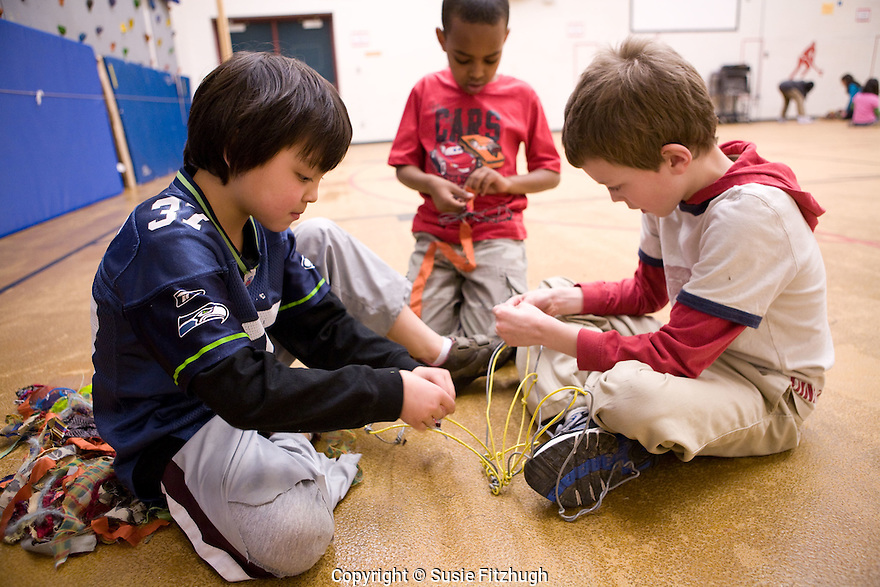 "Students at Kimball Elementary School, Seattle make creatures for an Arts Corps/Planet Arc sculptural piece celebrating the ""Seeds of Compassion"" movement."