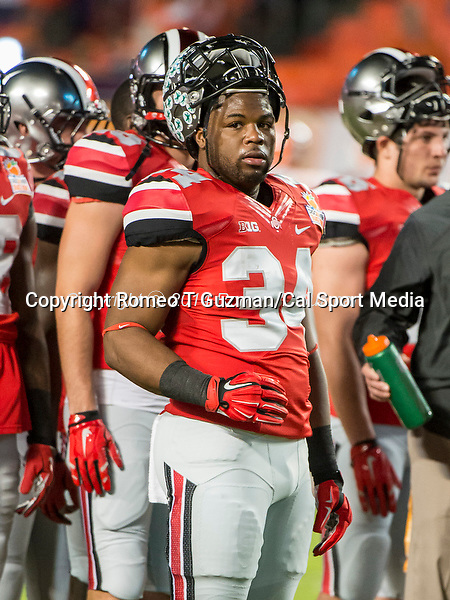 January 3, 2014 - Miami Gardens, Florida, U.S: Ohio State Buckeyes running back Carlos Hyde (34) before the Discover Orange Bowl game between the Clemson Tigers and the Ohio State Buckeyes at Sun Life Stadium in Miami Gardens, Fl